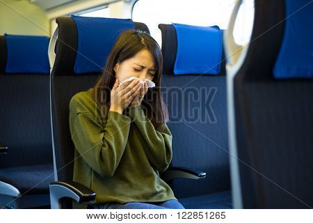 Woman sneeze on train compartment
