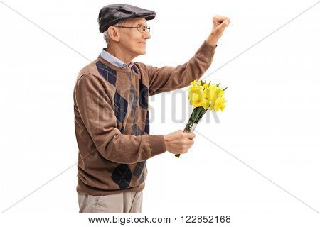 Senior holding flowers and preparing to knock on a door isolated on white background