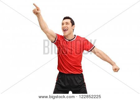 Delighted young football player celebrating a goal isolated on white background