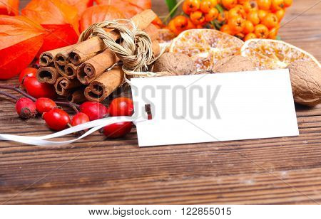 cinnamon rose hip and a small sign on the garden table