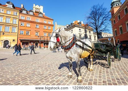 Warsaw, Poland, 13 March 2016: Horse Carriage At Main Square In Warsaw In A Sunny Day. Warsaw Is The