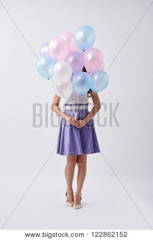 Birthday girl with bunch of colorful  balloons