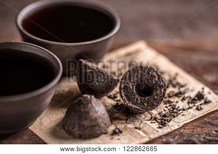 Still life with pressed pu-erh tea and crockery tea set