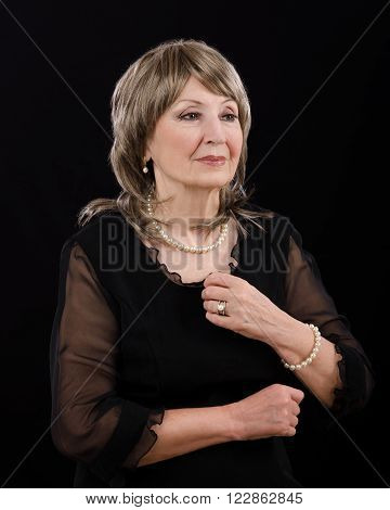 Portrait gorgeous older woman with imitation pearl set