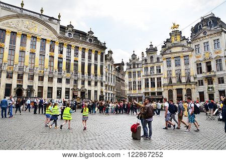 Brussels Belgium - May 13 2015: Many tourists visiting famous Grand Place (Grote Markt) the central square of Brussels. The square is the most important tourist destination and most memorable landmark in Brussels.