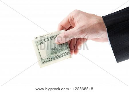 A businessman's hand with a one hundred dollars