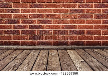 Empty 3D room space for product placement wooden floor and exposed red brick wall as copy space
