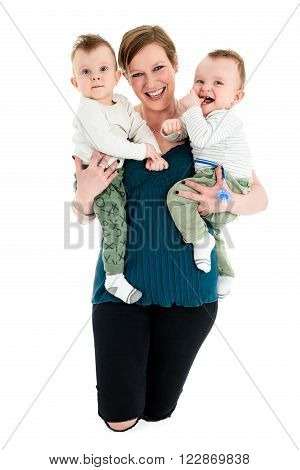 Mother Is Carrying Twin Boys And Smiling