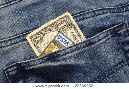 KHARKIV, UKRAINE - MARCH 16, 2016: American dollar, passport, credit cards Visa  sticking out of the pocket of jeans