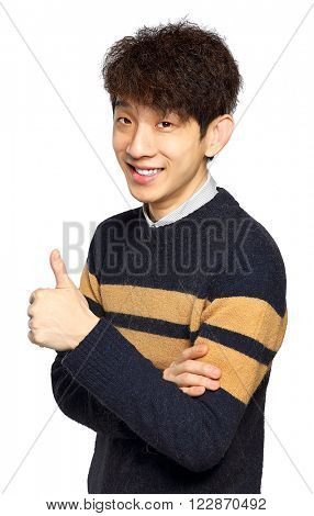 Young laughing asian man showing thumb up hand gesture isolated on white background