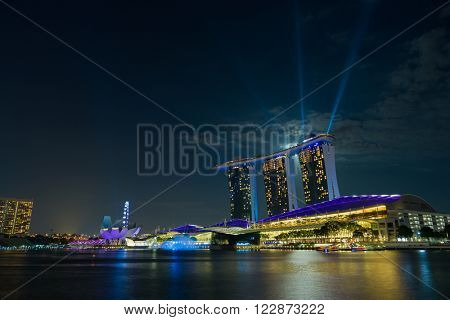 SINGAPORE CITY, SINGAPORE - FEBRUARY 22, 2016: Marina Bay Sands at night during Light and Water Show 'Wonder Full' . It opened on 27 April 2010. Singapore on FEBRUARY 22, 2016