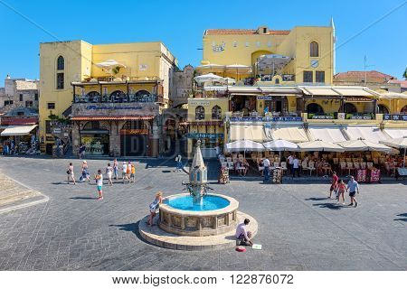 RHODES ISLAND, GREECE - JULY 4: Tourists walking on Hippocrates square in the historic old town of Rhodes, Greece on July 4, 2015. Rhodes is an island in Greece, located in the eastern Aegean Sea