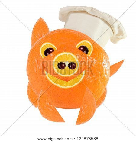 Creative food concept. Little Chef is a funny pig made from oranges.