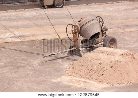 Cement mixer for small construction site and the sand