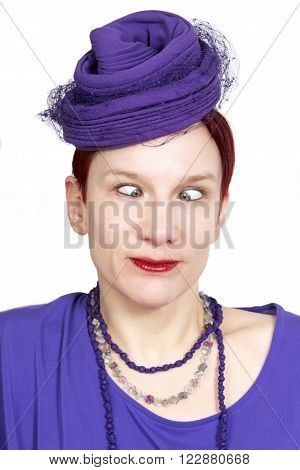 portrait of cross-eyed red-haired woman with purple hat