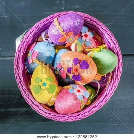 easter eggs in violett basket. Top view.