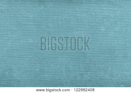 texture of rough old material from cotton or from a sackcloth for a textile background or for wallpaper of blue green color with attritions