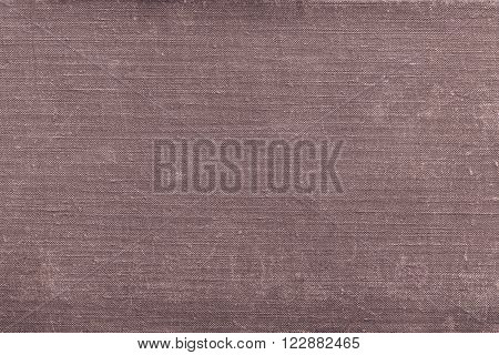 texture of rough old material from cotton or from a sackcloth for a textile background or for wallpaper of brown color with attritions