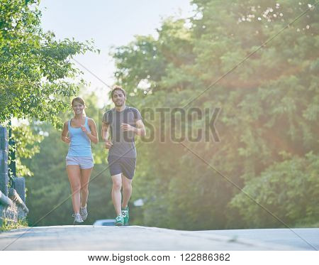 Young people jogging outdoors