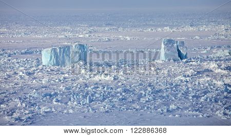 Aerial view of iceberg in frozen Arctic Ocean