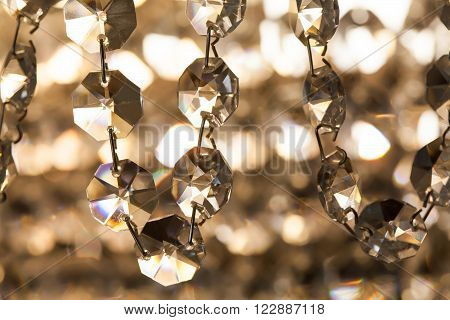 Retro style crystal chandelier. transparent pendant macro view. light background soft focus photography