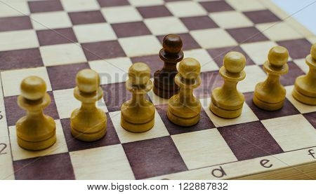 The chessboard white and black pawns atack