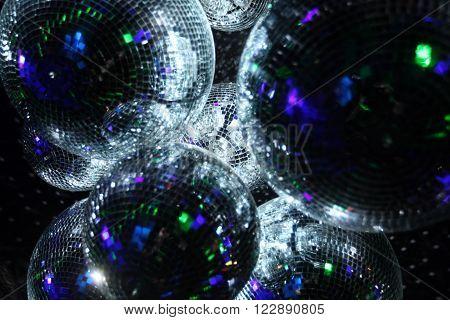 Shiny disco balls on a dark background