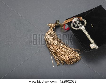 mini mortar board with antique key