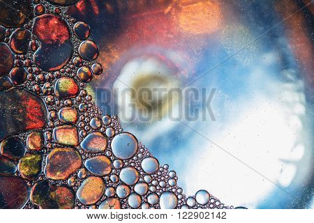 Close up oil floating on water surface used as backgrounds