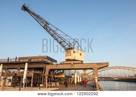 FRANKFURT GERMANY - MAR 14: Crane at the old Osthafen port at Main river in Frankfurt. March 14 2016 in Frankfurt Main Germany