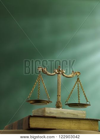 law scale on top of the law book