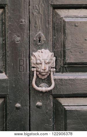 This is an old knocker on a door.