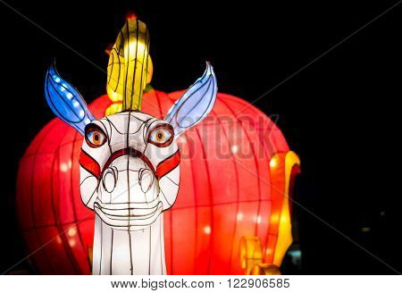 London United Kingdom - February 07 2016: Magical Lantern Festival at Chiswick House And Gardens. A horse head lantern on a bright red background