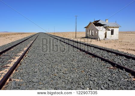 The destroyed building of the railway station and railway in the Namib Desert