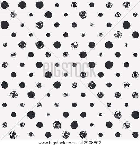 Seamless polka dot pattern. Dry brush painted circles with rough edges. Trendy hipster texture. Hand drawn endless stylish backdrop. Black shapes on white background. Cloth design, wallpaper, wrapping