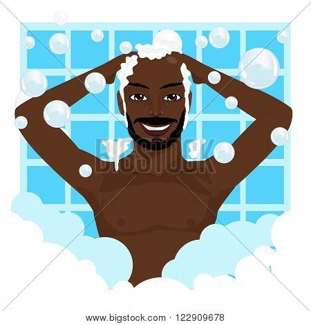Young happy african american smiling man washing his hair with shampoo