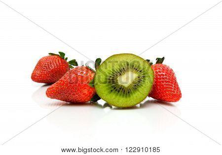 kiwi and fresh strawberries on a white background. horizontal photo.