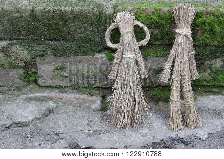 Figures of men made by children of dry grass