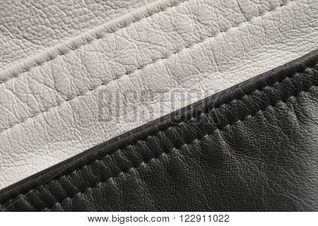 Black and white leather background. Stitching detail