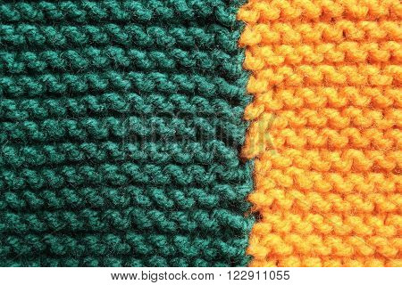 Macro shot of a knitted blanket, orange and teal