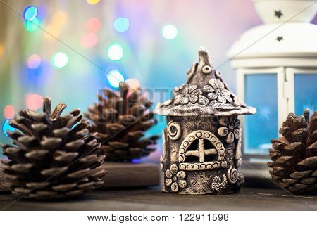 The houses made of mud, standing on a wooden board. Fairy houses for dwarfs wizards.