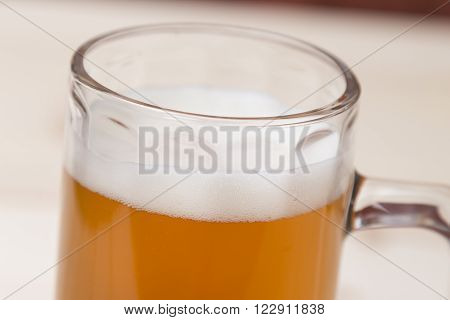 Close up of unfiltered draft beer in the mug.