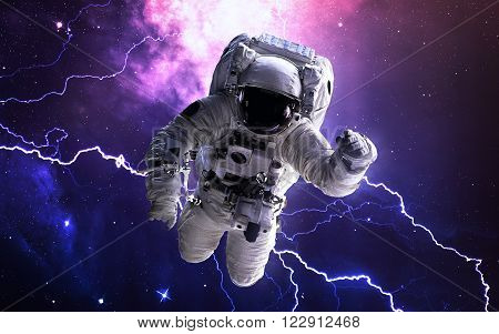 Astronaut in outer space. Spacewalk. Elements of this image furnished by NASA ** Note: Soft Focus at 100%, best at smaller sizes