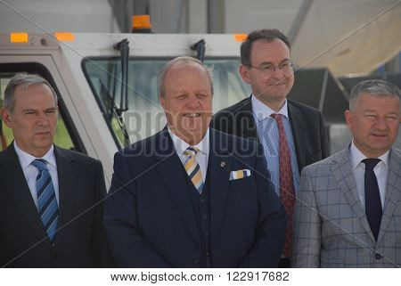 ANKARA/TURKEY- APRIL 29: President of Ankara Chamber of Industry Mr. Nurettin Ozdebir (2nd left) at the Turkish Aerospace Industry-TAI's apron for delivery ceremony of Airbus A400M military aircraft parts. April 29, 2015-Ankara/Turkey