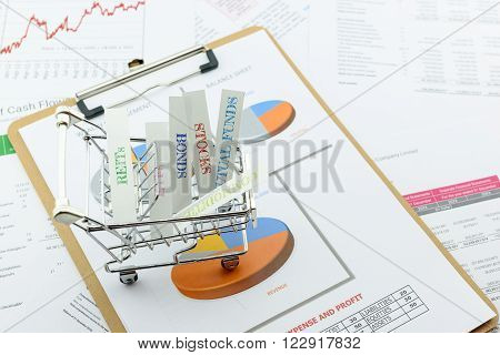 Various type of financial and investment products in a shopping cart i.e. REITs, ETFs, bonds, stocks. Sustainable portfolio management, long term wealth management with risk diversification concept.