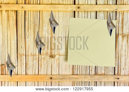 Blank piece of paper attached on an old house bamboo wooden wall with Japanese ninja concealed weapons. Copy space for leaving several messages when you are not at home i.e. orders, tasks, hints, news