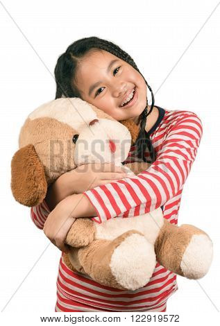 Cute little girl,dreadlocks hair style playing together with her doll, Isolated over white with clipping path