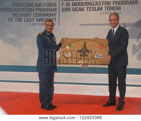 ANKARA/TURKEY-SEPTEMBER 2: Pakistan Air Force's Air Marshal Sohail Aman (L) and Muharrem Dortkasli (President & CEO of TAI) at the ceremony of