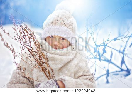 The portrait girl in the snow dressed in white