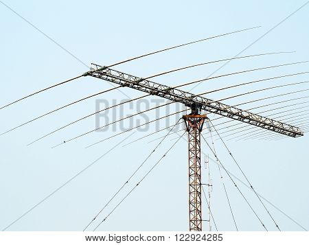 Telecommunication mast TV antennas with blue sky. High transmitter tower.